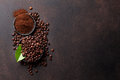 Coffee beans and ground powder Royalty Free Stock Photo