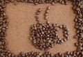 Coffee beans on grunge frame cup create by wooden board background Stock Image