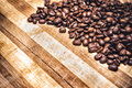 Coffee beans on grunge wooden background Royalty Free Stock Image