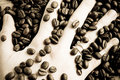 Coffee beans and hand Royalty Free Stock Photography