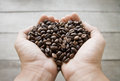 Coffee beans in hand heart shape Stock Images