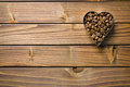Coffee beans in heart form top view of on wooden table Royalty Free Stock Photography