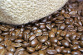 Coffee beans and jute bag texture details of Stock Images