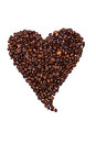 Coffee beans laid out a heart isolated on white background Royalty Free Stock Photography