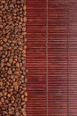 Coffee beans lying on a bamboo mat background menu Stock Photography