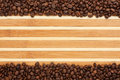 Coffee beans lying on a bamboo mat place for your text Stock Image
