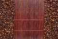 Coffee beans lying on a bamboo mat place for your text Royalty Free Stock Photography