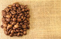 Coffee Beans on material Stock Photography