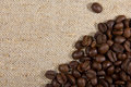 Coffee beans on the natural burlap Stock Photography