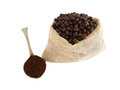 Coffee beans and powder in a gunny bag Royalty Free Stock Photos