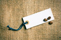 Coffee beans and price tag on burlap Stock Image