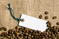 Coffee beans and price tag on burlap Royalty Free Stock Photo