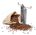 Coffee beans sack with two metal coffee grinders Royalty Free Stock Photography