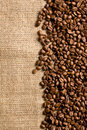 Coffee beans on sackcloth top view of Stock Images