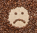 Coffee beans sad smile Royalty Free Stock Image
