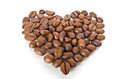 Coffee beans in the shape of heart Stock Photos