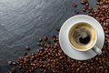 Coffee and beans on slate a dark Stock Photo