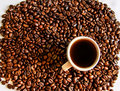 Coffee beans with small cup of coffee Stock Photos
