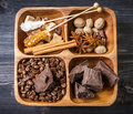 Coffee beans spices chocolate and sweets sugar assorted in a wooden box Stock Photos