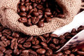 Coffee beans spilling Stock Photos
