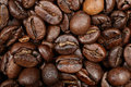 Coffee beans texture background closeup dark roast arabica bean Stock Images