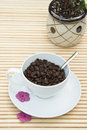 Coffee beans in a white cup wi Stock Image
