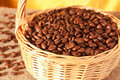 Coffee beans in a wicker basket Stock Photos