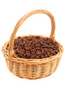 Coffee beans in a wicker basket isolated Stock Images