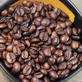Coffee beans on wood texture soft focus Royalty Free Stock Images