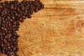 Coffee beans on wooden background with copy space Stock Photography