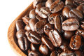 Coffee beans in wooden basket isolated Royalty Free Stock Photos
