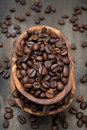 Coffee beans in a wooden bowl on the table Stock Photography