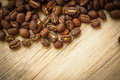 Coffee beans on a wooden desk Royalty Free Stock Photo