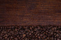 Coffee beans on wooden desk Royalty Free Stock Photo