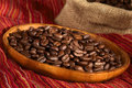 Coffee Beans on Wooden Plate Stock Photo