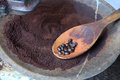 Coffee beans on wooden scoop Royalty Free Stock Photos
