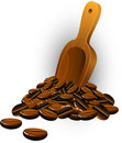 Coffee beans and wooden spatula Stock Images