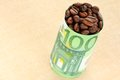 Coffee beans wrapped with banknote euro Stock Images