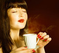 Coffee beautiful girl drinks aromatic Stock Photography