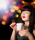 Coffee beautiful woman with cup of hot beverage Royalty Free Stock Image