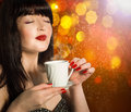 Coffee beautiful woman with cup of hot beverage Stock Photos