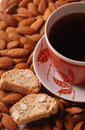 Coffee with biscotti on almond background Royalty Free Stock Photo