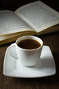 Coffee and book black strong on the table reading Stock Images