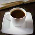 Coffee and book black strong on the table reading Royalty Free Stock Photo