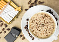 Coffee break aerial view of cup of lighter and cigarettes Royalty Free Stock Images