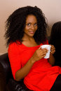 Coffee break a beautiful african american woman drinking Royalty Free Stock Photography