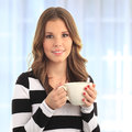 Coffee break beautiful young woman smiling and drinking a cup of Royalty Free Stock Images