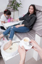 Coffee break in beauty salon during spa procedure Royalty Free Stock Photo