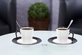 Coffee break closeup photo of two cups on a table Royalty Free Stock Photo