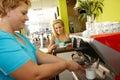 Coffee break in fitness club pretty women taking a having served by fat woman Stock Photo